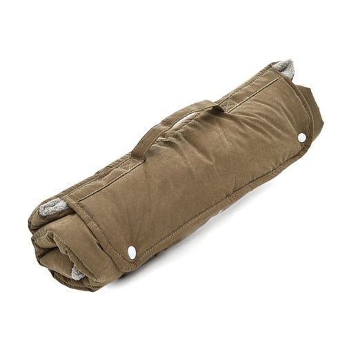 tan pet mat, rolled up and easy for travelling