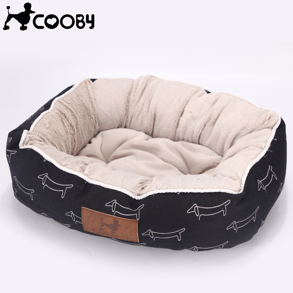 rectangular cream and navy pet bed with a white dog pattern and canvas bottom