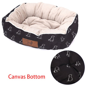 rectangular cream and black pet bed with a white dog pattern and canvas bottom