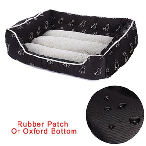 rectangular cream and black pet bed with a white dog pattern and a rubber bottom