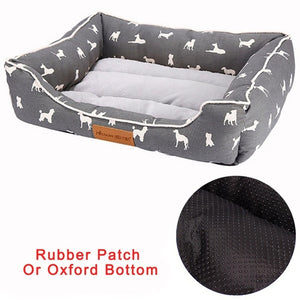 rectangular cream and grey pet bed with a white dog pattern a rubber bottom