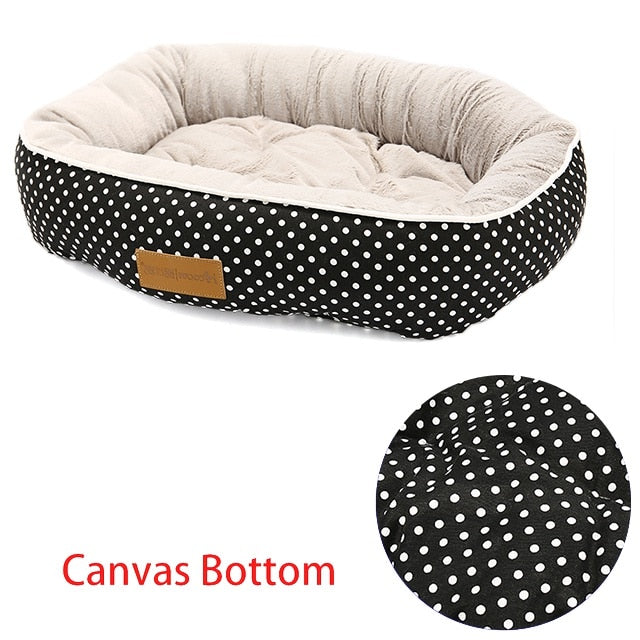 rectangular cream and black pet bed with a white polk a pot pattern and a canvas bottom