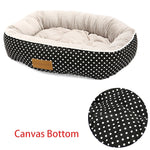 rectangular grey pet bed with a white dog pattern and canvas bottom
