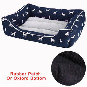 rectangular grey and navy pet bed with a white dog pattern and rubber bottom