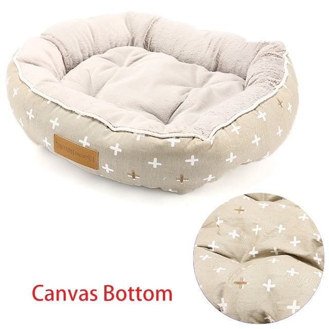 rectangular cream  pet bed with a white star pattern and canvas bottom