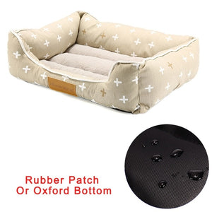 rectangular cream pet bed with a white start pattern and rubber bottom