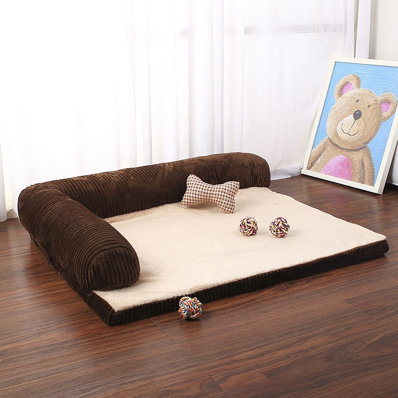 rectangular brown and tan pet bed with plush pet toys on it