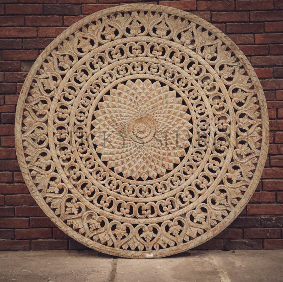 Intricate carved round panel