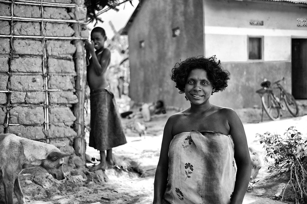 Woman in Front Yard - Uganda