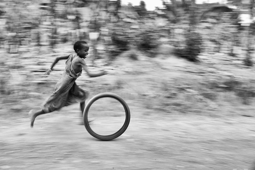 Child With Tyre, Uganda