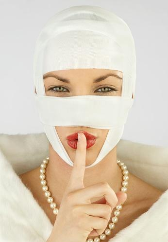 Woman Whispering With Thread Lifts On Her Face