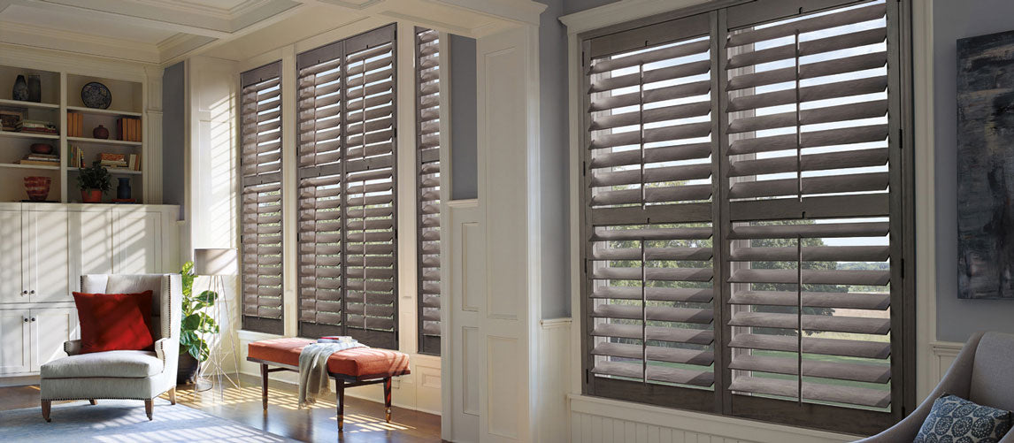 A beautifully designed window treatment and a painted wall by Benjamin Moore Paints offered by Customdecor
