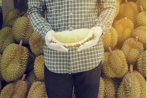 Man holding a durian