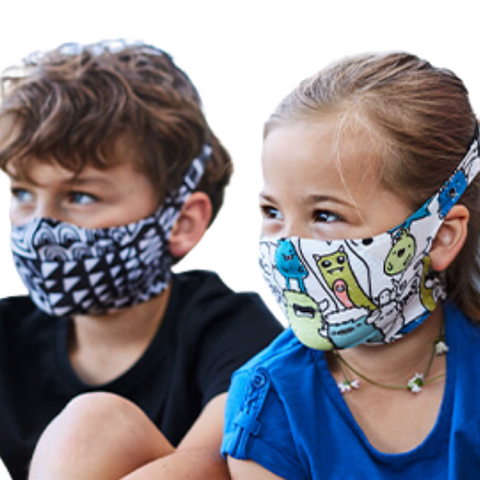 Kids wearing ski-friendly masks from Buff