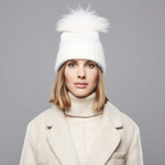 A woman wearing a Chaos Giana Beanie in Winter White