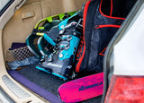 Pair of Nordica Promachine 95 W 2021 ski boots in a car