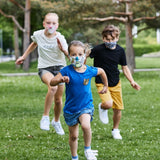 Kids running after each other, wearing Buff Kids' Filter masks