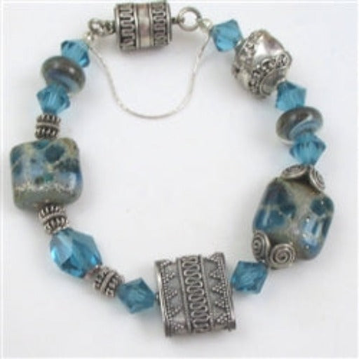 Whimsical silver and artisan bead bracelet