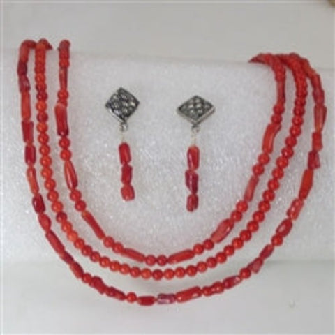 Trio of coral multi-strand necklace matching earrings