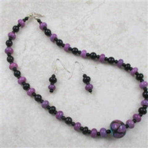 Purple beads paired with black onyx beads in this artisan handmade necklace & earrings