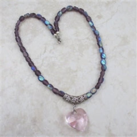 Lilac Swarovski crystal heart on a strand of lilac fire polished bead necklace