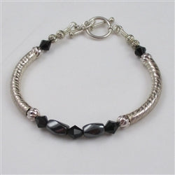 Classic pairing of hemitite and sterling silver in a bangle bracelet