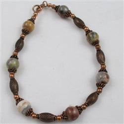 The warm glow of copper paired with agate gemstone beads in an anklet
