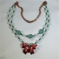 Buy Handcrafted copper butterfly & sea glass necklace