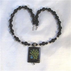 Buy Big Bold hand painted peacock pendant on a calssic black bead necklace