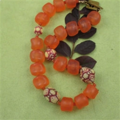 Orange nugget statement necklace with beaded bead accents