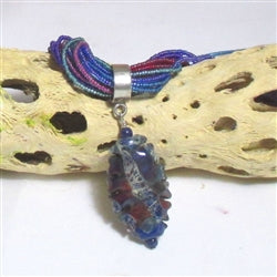 Multi-colored seeg bead necklace with handmade artisan pendant