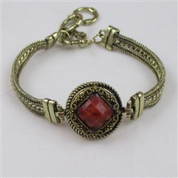 Buy dark orange crystal on an antique gold bangle bracelet