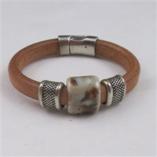 Natural leather bracelet with handmade bead accent for a woman