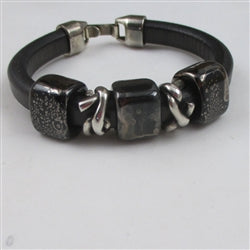 Plus size genuine leather cord bracelet in classic black with handmade accents