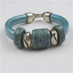 Genuine leather cord bracelet with handmade ceramic accent  sea green color