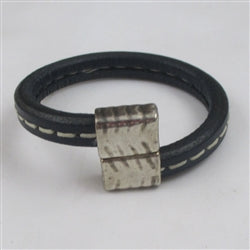 Navy blue leather cord bracelet with unique off set clasp