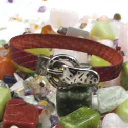 Red leather bracelet with silver buckle clasp