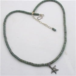 green surfer necklace for a man with starfish pendant