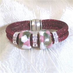 Sparkly rose metallic cord with a fair trade beads accent