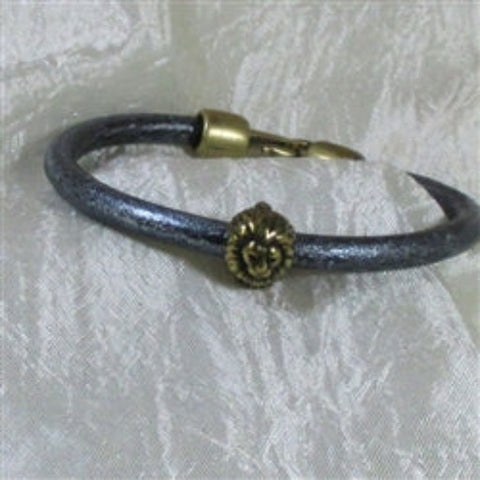 Leather cord braceletwith a lion accent for a child