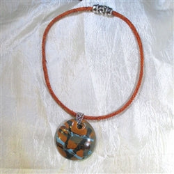 Handmade fair trade kazuri pendant on vintage orange leather necklace