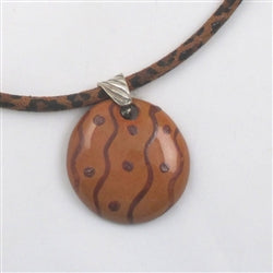 Delightful handmade fair trade kazuri pendant on leopard suede necklace