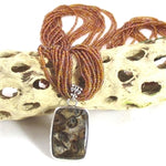 Rhyolite Opal pendant on a long sandstone multi-strand necklace pendant necklace