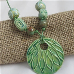 Green Fair Trade Pendant on green leather cord necklace