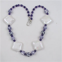 Big bold fair trade bead white, & purple Kazuri necklace