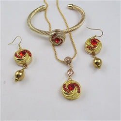 Designer's choice gold & red crystal pendant necklace, matching earrings & matching bracelet