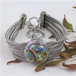 Buy a cuff  bangle bracelet with multi-colored swirled accent