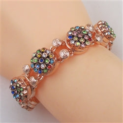 Multi-colored rhinestone accents on a rose gold bangle bracelet