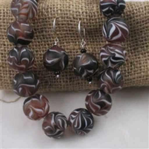 Buy black & white swirled with brown handmade bead necklace & earrings