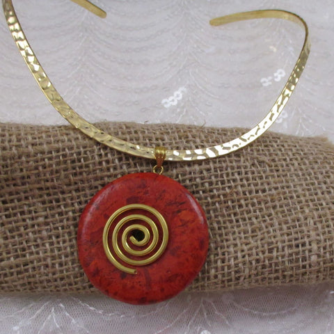 Red Gemstone Pendant on Gold Neck Wire